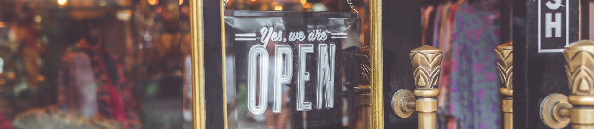 Open sign on business window.