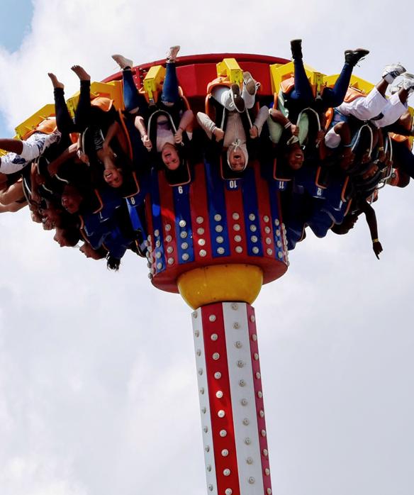 group riding upside down on an amusement park ride