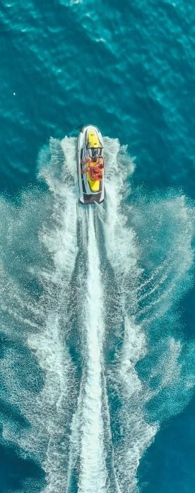 Jet ski going through water. Americas Credit Union jet ski loans.