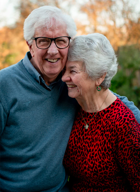 a money market account from america's credit union earns you more - elderly couple smiling