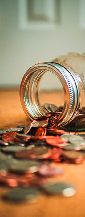 the best money market rates from america's credit union can help you save - jar of change spilling out