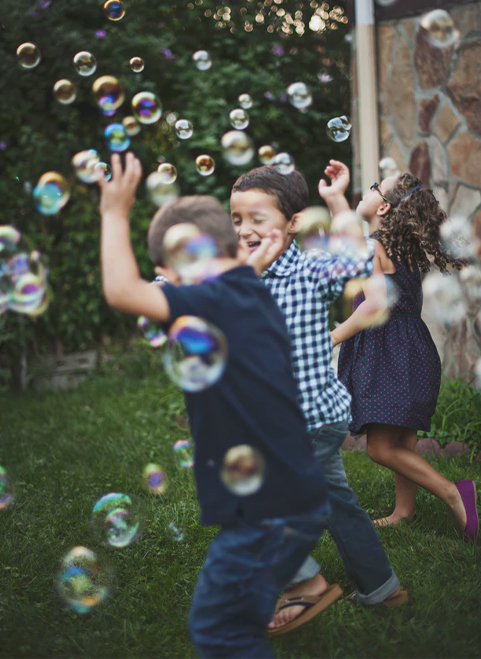 best savings account for kids is at america's credit union kids laughing running through bubbles