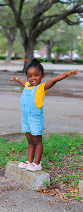 kids bank accounts from america's credit union help your child grow young girl with arms stretching high