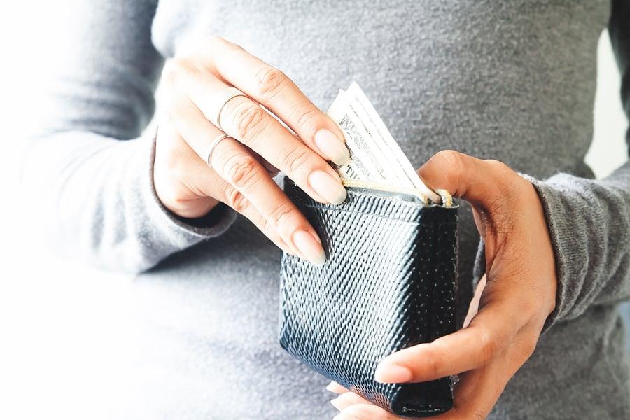bigstock-Woman-Hands-Holding-Us-Dollar--255700855