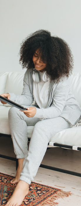 estatements through america's credit union offer great benefits image of college student looking at tablet