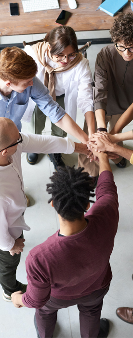 group of employees with hands in circle