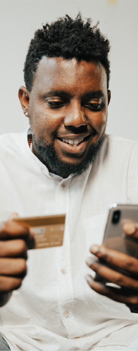 man on his phone paying with his credit card