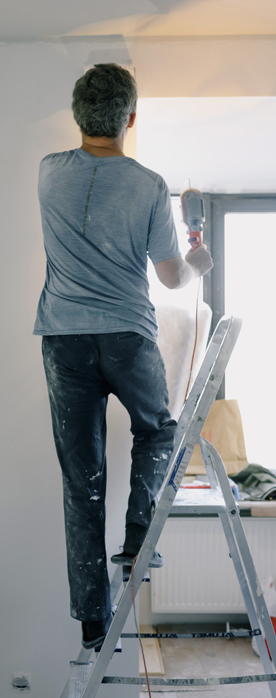 man on ladder doing home improvements