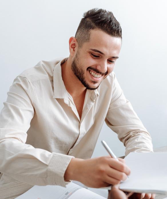 man signing his TruStage Insurance paperwork