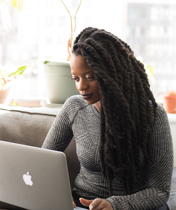 woman researching wire transfers on her laptop