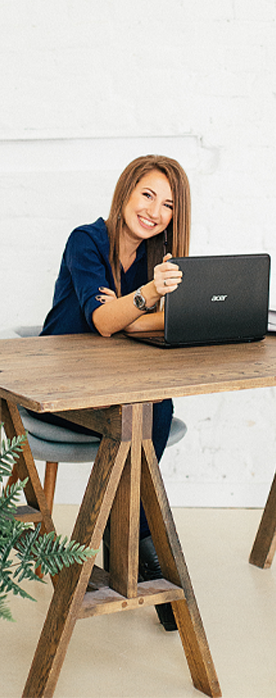 woman reviewing an annual report on her laptop