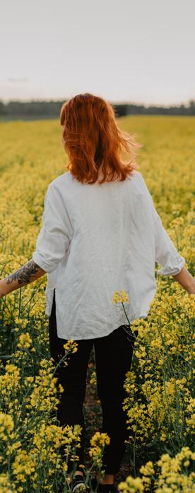 woman walking through relaxing flower field